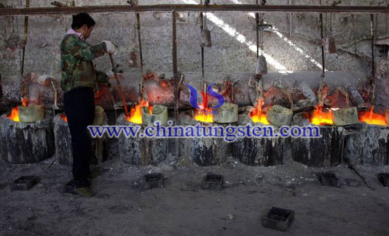 China produces 80 percent of the global rare earths and a worker at the smelting workshop image